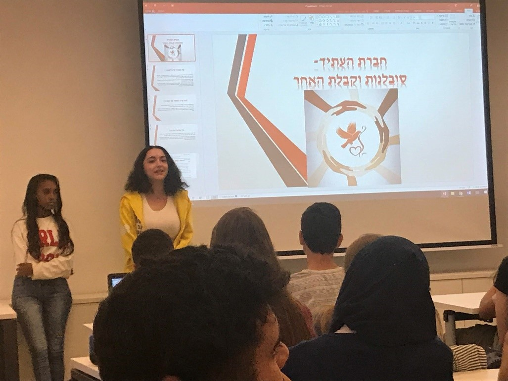 Members of the group present their ideas to other groups at TAU summer university